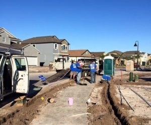 ATZ irrigation technicians working on a lawn and landscape irrigation installation