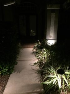 outdoor lighted sidewalk at night